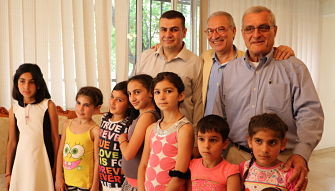 Executive Director Mihran Mirijanyan & Board Members  Varouj Alterbarmakian and Garo Garibian with younger program  participants